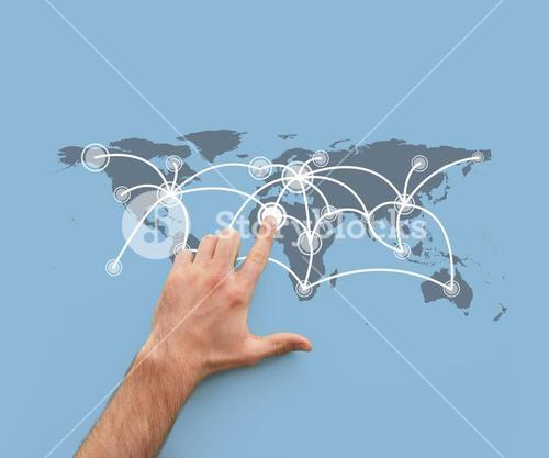 Hand touching a map showing global connections