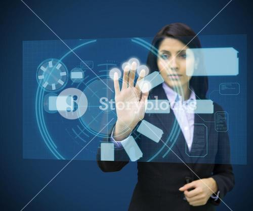 Concentrate woman touching a hologram