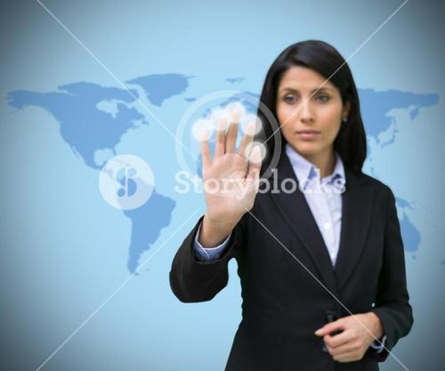 Woman pressing hand to holographic screen
