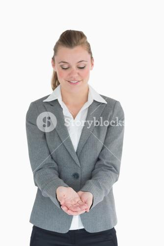 Blonde woman looking at her hands