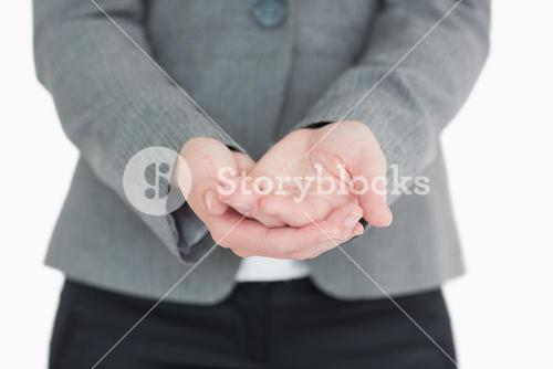 Businesswoman holding out hands
