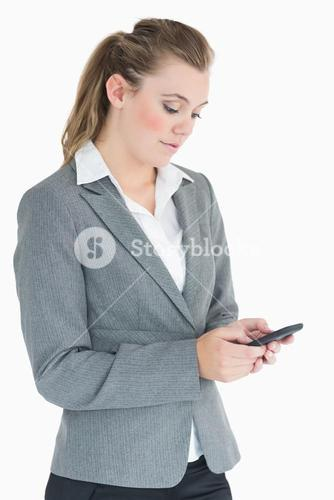 Businesswoman texting with her smartphone