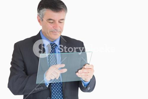 Businessman pressing something on pane