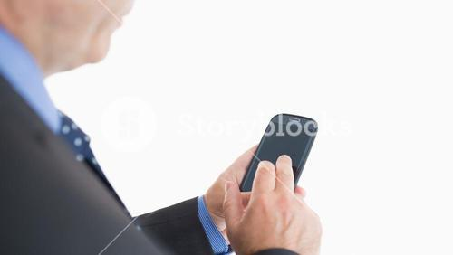 Businessman texting with smartphone