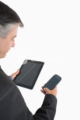Businessman holding tablet pc and mobile phone