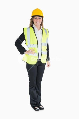 Woman in a suit wearing builders clothes