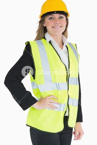 Smiling woman wearing vest and helmet