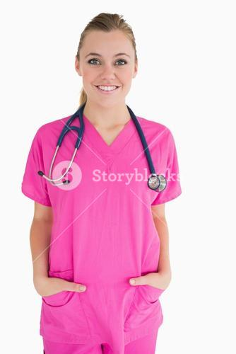 Happy doctor in pink scrubs