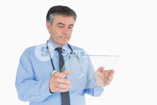 Doctor studying clear pane