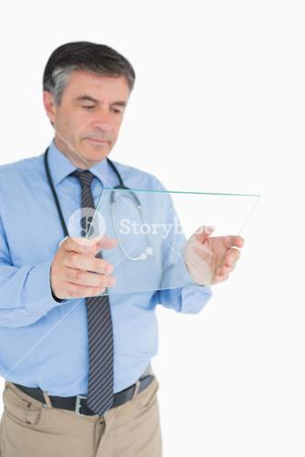 Doctor holding a clear pane