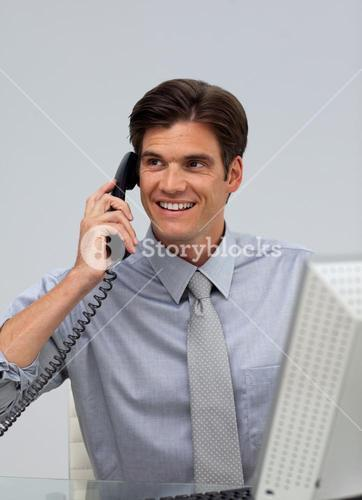 Assertive businessman on phone