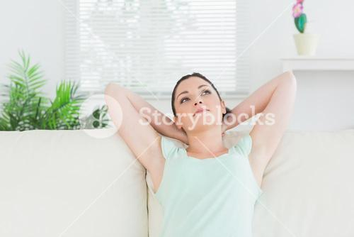 Carefree woman sitting on a couch
