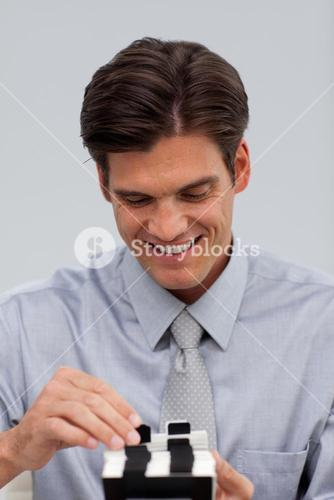 Cheerful businessman consulting a business card holder
