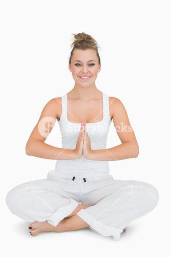Girl sitting crosslegged in yoga pose