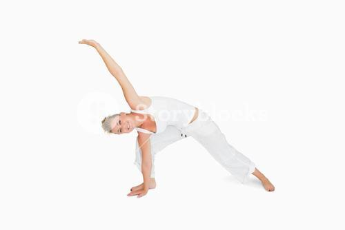 Girl in extended triangle yoga pose