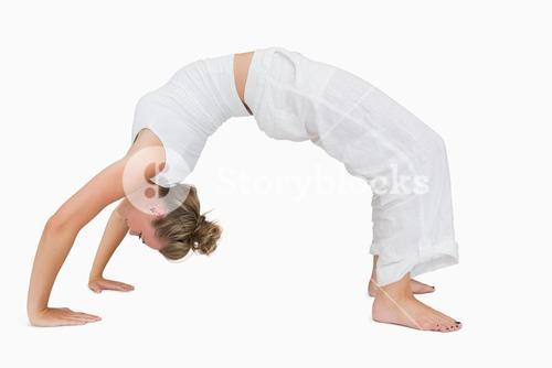 Girl in upward bow yoga pose