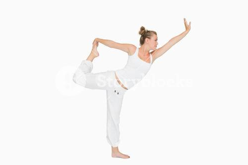 Girl in lord of the dance yoga pose
