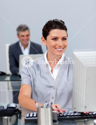 Smiling business woman working at a computer
