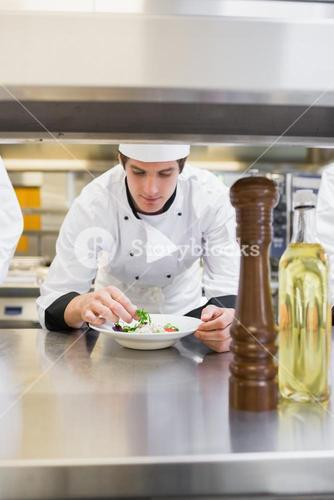 Chef finishing his salad