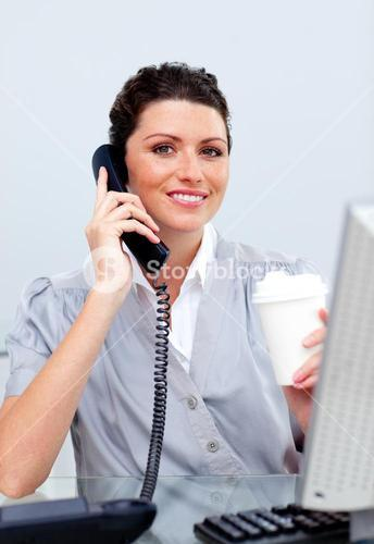 Joyful business woman on phone