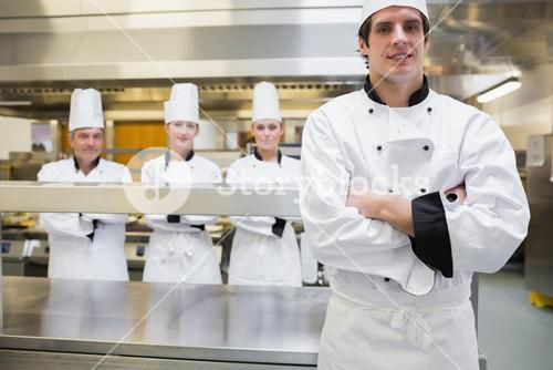 Male chef standing in kitchen