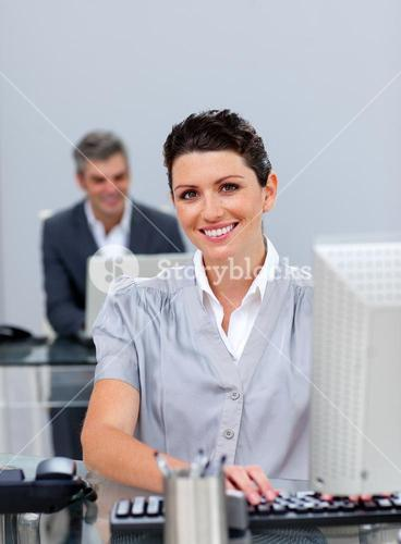 Confident business woman working at a computer