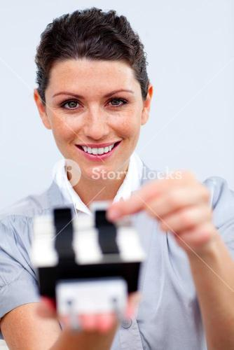 Positive businesswoman consulting a business card holder