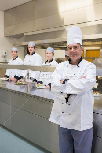Head chef standing with arms crossed