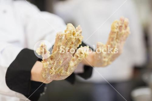 Hands covered in dough