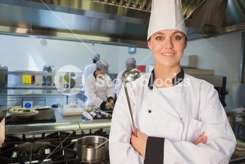 Smiling chef holding ladle