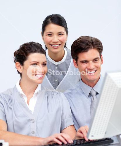 Ambitious business people working at a computer