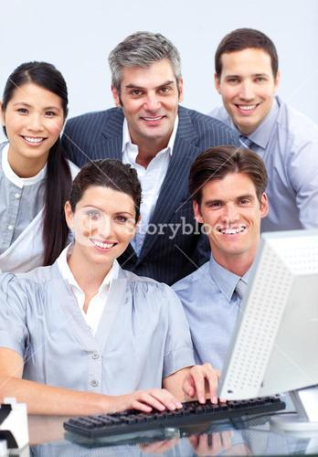 Successful business people working at a computer