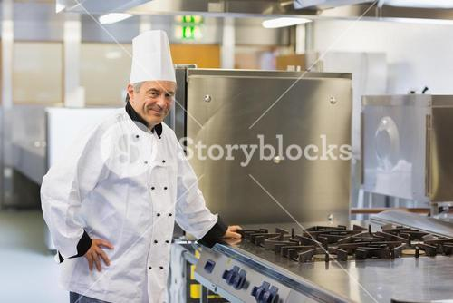 Chef leaning on stove
