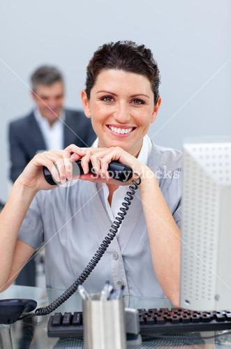 Brunette business woman on phone