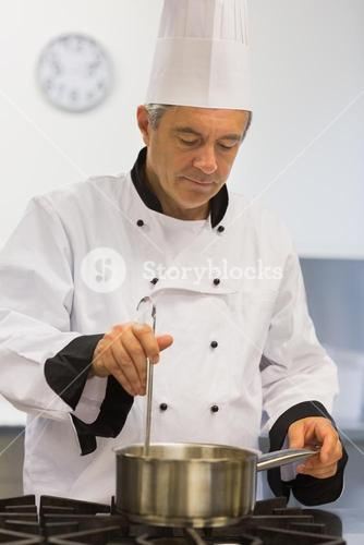 Chef cooking sauce