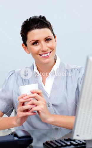 Smiling business woman drinking coffee