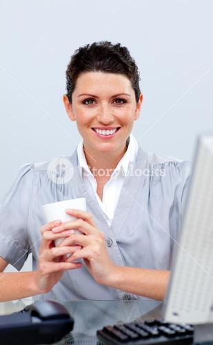 Positive business woman drinking coffee
