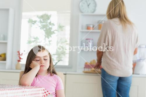 Child falling asleep at kitchen table