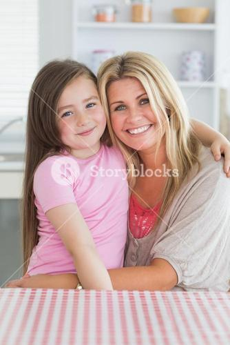 Girl sitting on mothers lap
