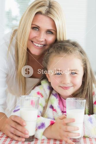 Mother and girl drinking milk