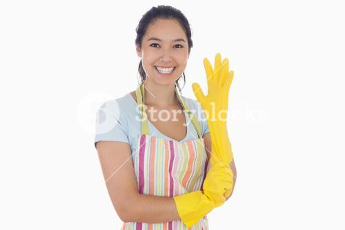 Smiling woman pulling on rubber glove