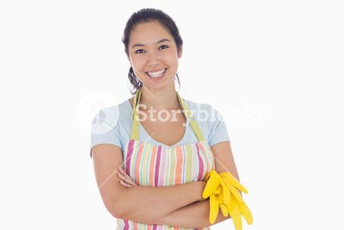 Woman smiling and holding rubber gloves