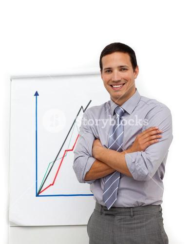 Businessman with folded arms giving a presentation