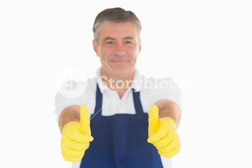 Man giving thumbs up in rubber gloves