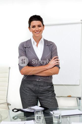 Selfassured female executive with folded arms