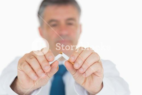 Man breaking cigarette