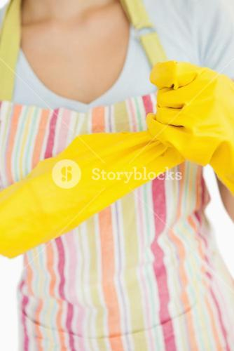 Woman pulling off rubber gloves