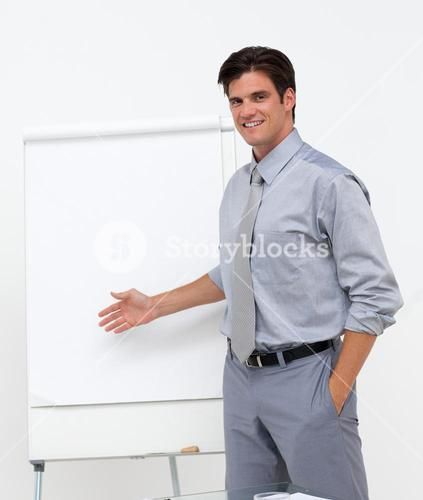 Selfassured businessman pointing at a board
