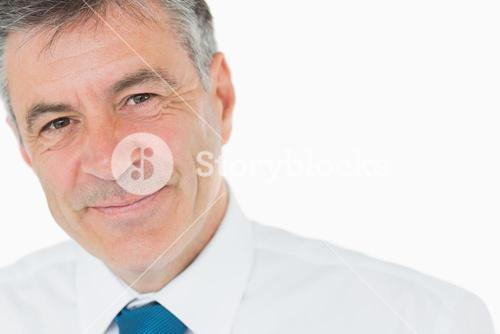 Smiling grey haired businessman