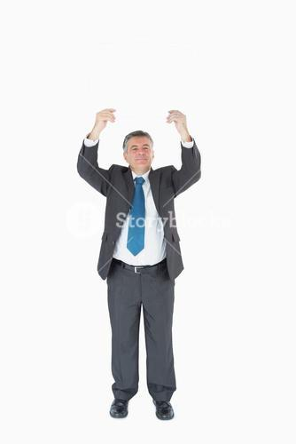 Businessman with hands up